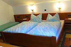 [Wohnung]Schlafzimmer der Ferienwohnung 2 mit Zustellbett
